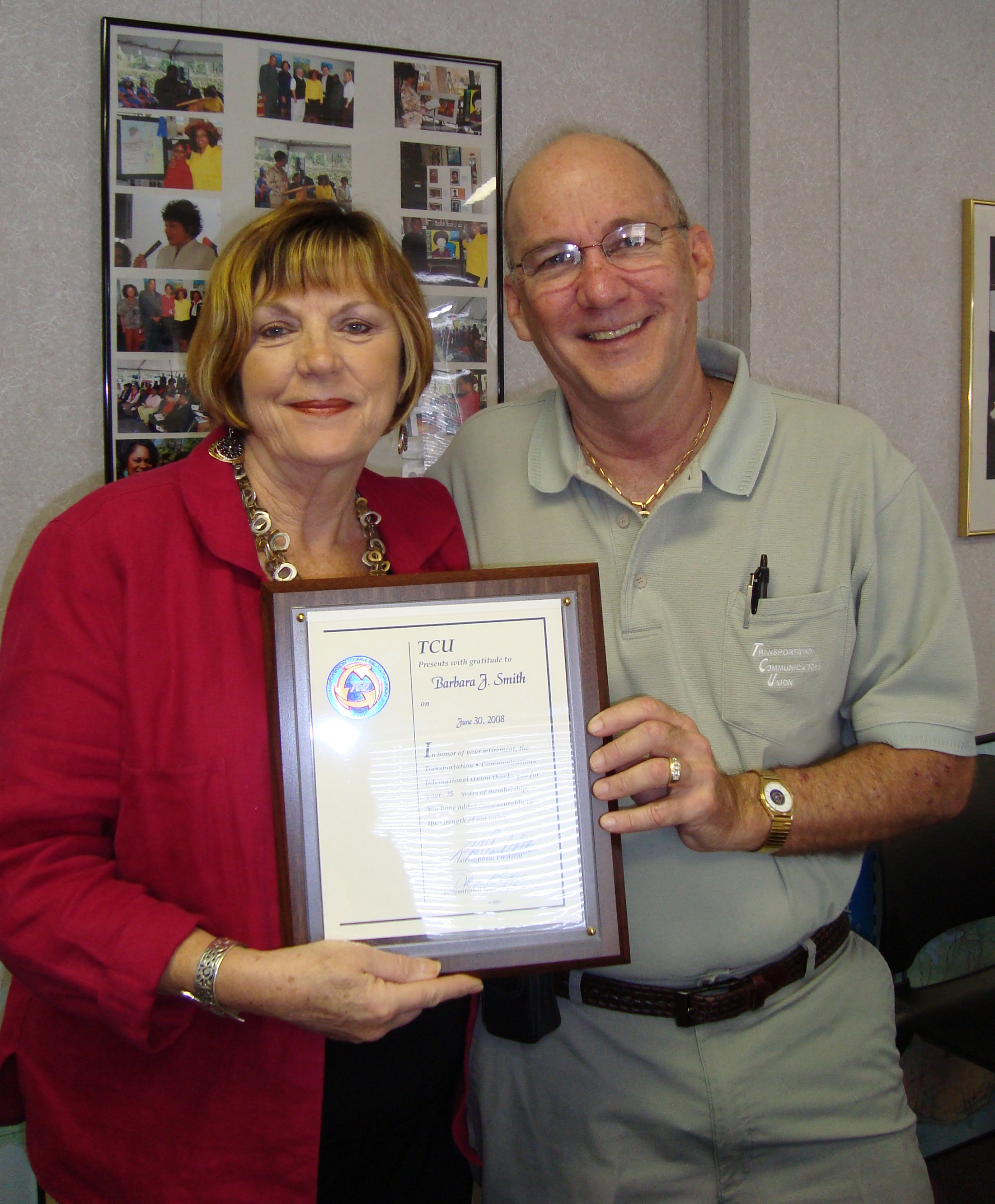 Barbra Smith receiving retirement plaque from Local Chairman N  White Jr.JPG