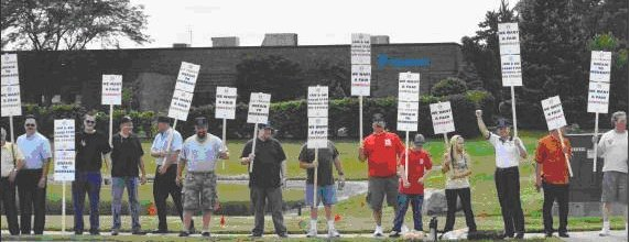 Striking members of Local 2159 picket on the road to U.S. Tsubaki in Wheeling, IL