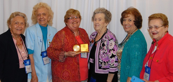 Lehman poses with the award and fellow delegates at the National Federation of Democratic Women's conference in Charleston, WV.
