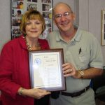 Barbra Smith receiving retirement plaque from Local Chairman N White Jr