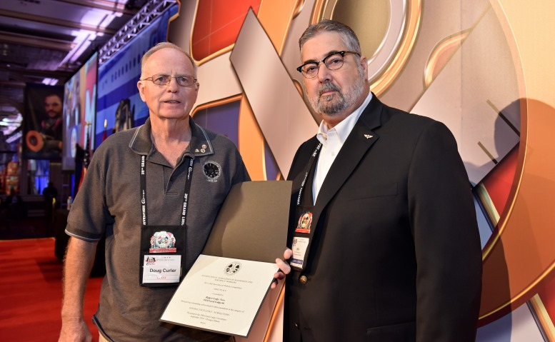 IAM Local 66 retiree Doug Curler, left, stands with IAM International President Bob Martinez at the IAM Newsletter and Website Contest awards ceremony held at the 39th IAM Grand Lodge Convention in Chicago.