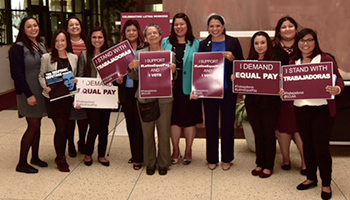 IAM General Secretary-Treasurer Dora Cervantes, fifth from left, shows her support for closing the Latina equal pay gap at AFL-CIO Headquarters in Washington, DC.