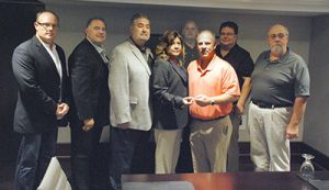 The IAM Auditors Association is now a reality. From left: IAM General Vice Presidents Brian Bryant and James Conigliaro, Sr., IAM International President Bob Martinez, IAM General Secretary-Treasurer Dora Cervantes, General Vice President Rickey Wallace, Auditors Association President Pat Smutney, Auditors Association Secretary-Treasurer Paul Kendall, and Grand Lodge Auditor Rick Fischer.