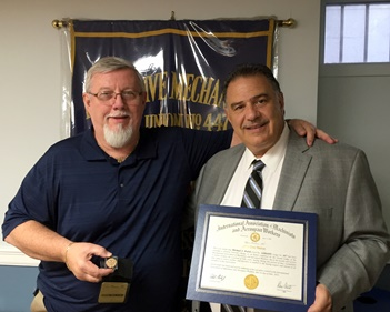 IAM Retiree Mike Walsh, left, receives his 50 year pin and certificate from Eastern Territory General Vice President Jimmy Conigliaro, Sr.