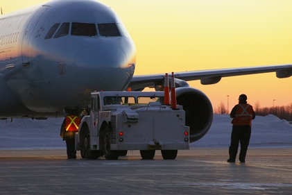 By planning legislation to allow foreign companies to own up to 49 percent of an airline in Canada, the Canadian government is risking thousands of IAM jobs, and those of other transport workers. (Air Canada jet pushback)